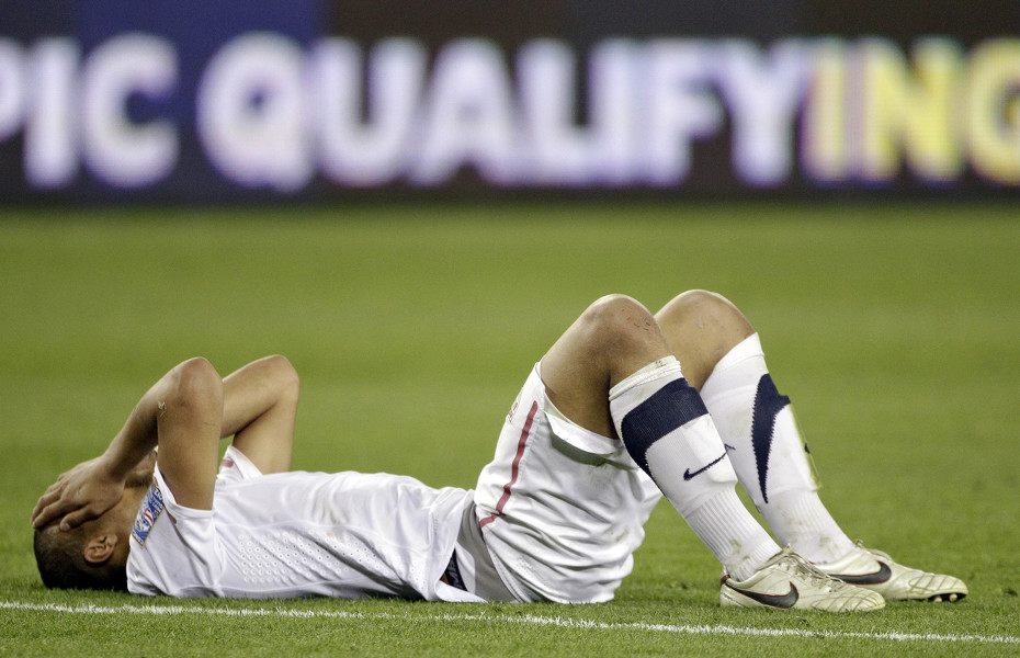 Terrence Boyd of the United States lies on the field after the United States tied 3-3 with El Salvador in a CONCACAF Olympic qualifying soccer match on Monday, March 26, 2012, in Nashville, Tenn. El Salvador scored in extra time to cause a 3-3 draw, eliminating the United States from Olympic qualifying. (AP Photo/Mark Humphrey)   AP2012
